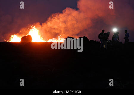 Members of the media view activity at fissure 7 at the Leilani Estates residential area caused by the eruption of the Kilauea volcano May 26, 2018 in Pahoa, Hawaii. - Stock Image