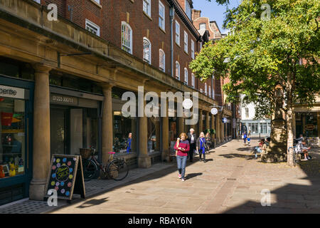People walking past shops on the pedestrianised Sussex Street on a sunny Summer afternoon, Cambridge, UK - Stock Image