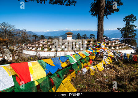 Colourful prayer flags and 108 chortens at Dochu La, a 3140-m pass on the road between Thimphu and Punakha in western - Stock Image