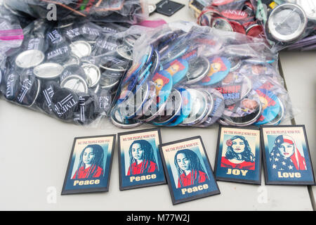 - New York, NY, USA. 8March 2018 Buttons available for sale to support Women. Women activists rallied in Washington - Stock Image