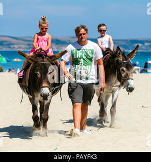 Donkey ride on the beach at Weymouth, Dorset, UK. - Stock Image