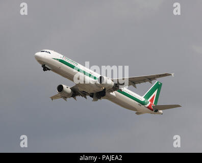 Alitalia Airbus A321-100 climbing out after take-off from Heathrow - Stock Image