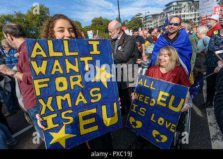 London, UK. 20th October 2018. A woman ulds a poster 'All I want for Xmas is EU'. People gather with placards, banners and flags at Hyde Park Corner for the People's Vote March calling for a vote to give the final say on the Brexit deal or failure to get a deal. They say the new evidence which has come out since the referendum makes it essential to get a new mandate from the people to leave the EU. Peter Marshall/Alamy Live News - Stock Image