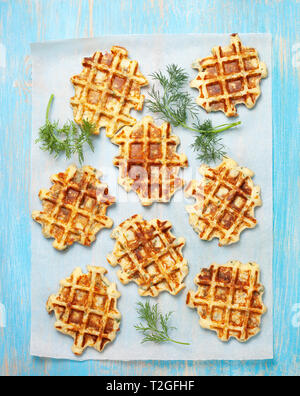 healthy breakfast. savory  spinach dill waffles on a blue background. view from above - Stock Image