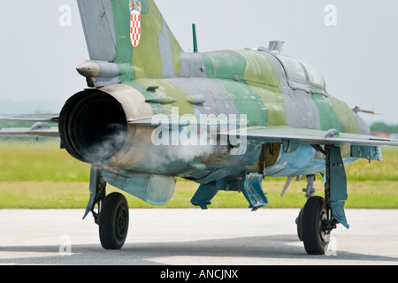 Croatian Air Force MiG-21 UMD taxiing and trailing smoke from engine, Pleso AFB during 'open day' visit - Stock Image