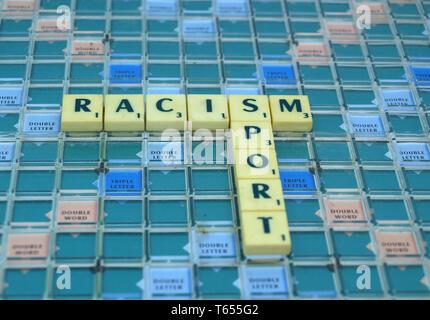 Racism in Sport written in Scrabble tiles - Stock Image