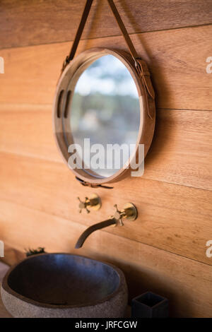 Mirror and basin in cottage - Stock Image