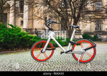 Modern city bicycle standing on the street - Stock Image