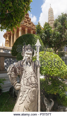 Protective Guardian Statue with Spear at Entrance to Religious Temple in Bangkok, Thailand, Asia. - Stock Image