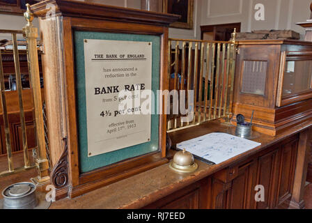 Reconstructed Victorian interior of  Barclays Bank circa 1900, with a prominent bank rate poster, Beamish Museum, County Durham - Stock Image