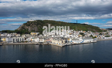 Horizontal shot with perspective from the fjord of Alesund, a tranquil port town with architecture in Art Nouveau style, and Mount Aksla - Stock Image