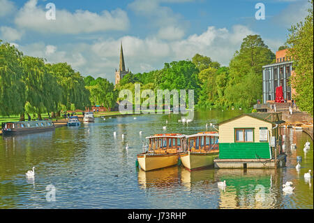 Stratford upon Avon, Warwickshire, England and a summer scene down the River Avon towards Holy Trinity church - Stock Image