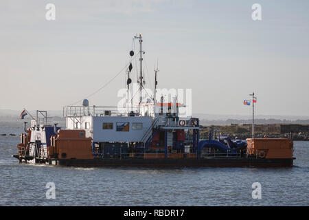 A Dutch-registered dredger works in waters of the Port of Ramsgate, a closed but once busy ferry terminal, on 8th January 2019, in Ramsgate, Kent, England. The Port of Ramsgate has been identified as a 'Brexit Port' by the government of Prime Minister Theresa May, currently negotiating the UK's exit from the EU. Britain's Department of Transport has awarded to an unproven shipping company, Seaborne Freight, to provide run roll-on roll-off ferry services to the road haulage industry between Ostend and the Kent port - in the event of more likely No Deal Brexit. In the EU referendum of 2016, peop - Stock Image