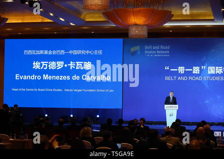 Beijing, China. 24th Apr, 2019. Evandro Menezes de Carvalho, head of the centre for Brazil-China Studies of the Getulio Vargas Foundation School of Law, speaks during the inauguration meeting of the Belt and Road Studies Network (BRSN) in Beijing, capital of China, April 24, 2019. The Belt and Road Studies Network (BRSN), co-initiated by Xinhua Institute and 15 other think tanks, was inaugurated in Beijing Wednesday. Credit: Zhang Yuwei/Xinhua/Alamy Live News - Stock Image