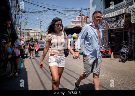 Older man, younger woman. Thailand Southeast Asia - Stock Image