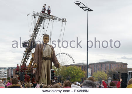 The Giant passes the Albert Dock during the Giants Spectacular parade through Liverpool city centre UK - Stock Image