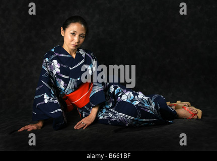 Japanese Woman in a Blue Kimono - Stock Image