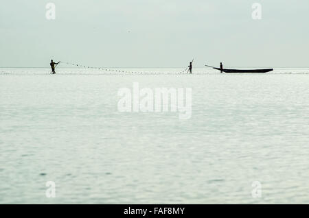 Fishermen in the shallow waters off the Turtle Islands, Sierra Leone. - Stock Image