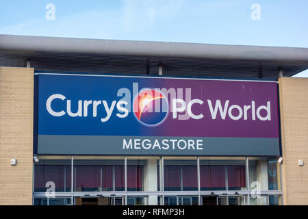 Currys PC World store. Sign outside a Currys PC World shop in Stevenage, UK - Stock Image