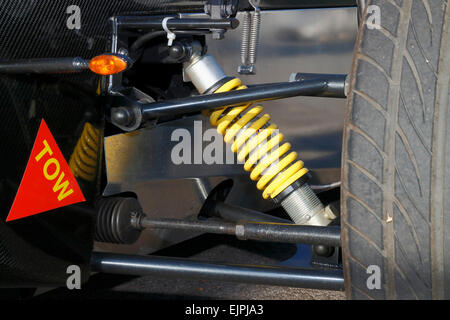 Coil over shock absorber on the front of an open wheeler race car. - Stock Image