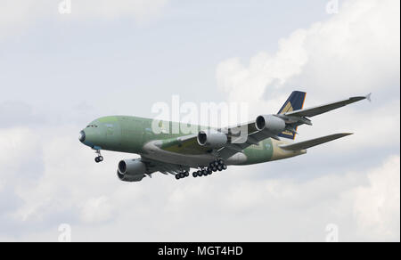 Hamburg, Germany - April 27, 2018: Airbus A380 landing at the Airbus Plant in Hamburg Finkenwerder after a test flight - Stock Image