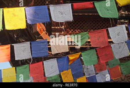 Tibetan prayer flags with text - Stock Image
