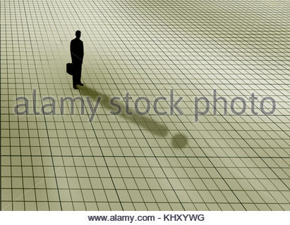 Businessman standing on graph paper grid casting exclamation mark shadow - Stock Image