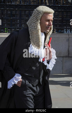 Mozammel Hossain QC leaves the House of Commons (the UK parliament) after being sworn in to his new position, on 11th March 2019, in London, England. Bangladeshi born barrister Hossain has been appointed Queen's Counsel. He was sworn in at the Westminster Hall at the Houses of Parliament in the UK on March 11, says a press release. He is the first criminal lawyer of Bangladeshi origin to be appointed as QC. He is also one of the youngest barristers ever to be appointed QC. - Stock Image
