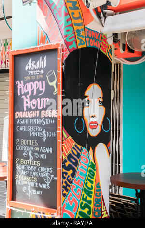 Singapore - 22nd December 2018: Happy hour menu outside bar on Haji Lane. This is in the Kampong Glam area - Stock Image