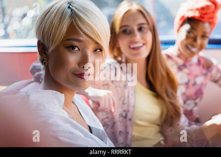 Portrait confident young women friends taking selfie - Stock Image