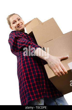 moving to new house - smiling young woman with stack of cardboard boxes - Stock Image