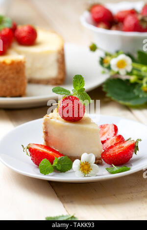 cheesecake with strawberries, fresh strawberries on a wooden background - Stock Image