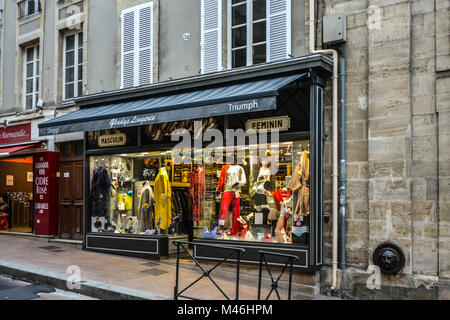 A colorful store display windown on a masculin and feminine lingerie shop in Bayeux France catering to men and women. - Stock Image