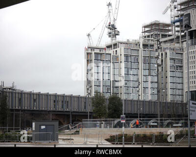 View from the bus station of new housing being built behind Westfield, White City - Stock Image