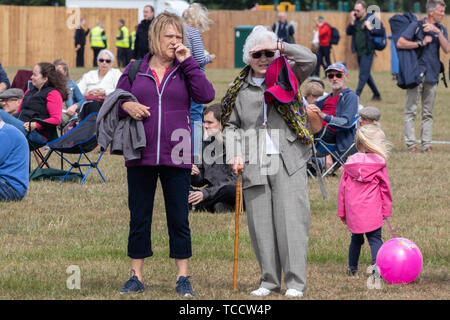 A grown woman and her elderly mother at an outdoor event - Stock Image