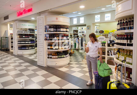 People in the Duty Free Shop, the terminal interior, Pisa International Airport, Pisa, Tuscany, Italy Europe - Stock Image