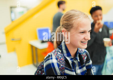 Smiling junior high girl student with braces - Stock Image