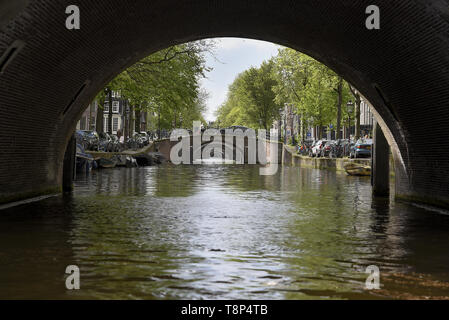 People (tourists) enjoy Amsterdam - city of cyclist, bikes, canals and coffeeshops, Netherlands, May 7, 2019. (CTK Photo/Drahoslav Ramik) - Stock Image