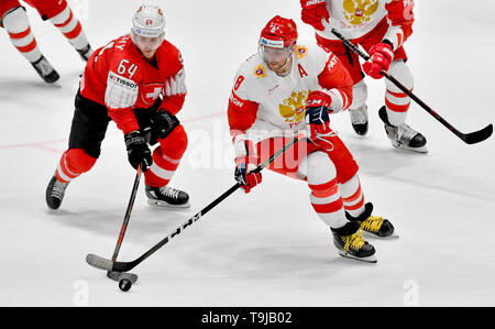Bratislava, Slovakia. 19th May, 2019. L-R Christoph Bertschy (SUI) and Alexander Ovechkin (RUS) in action during the match between Switzerland and Russia within the 2019 IIHF World Championship in Bratislava, Slovakia, on May 19, 2019. Credit: Vit Simanek/CTK Photo/Alamy Live News - Stock Image