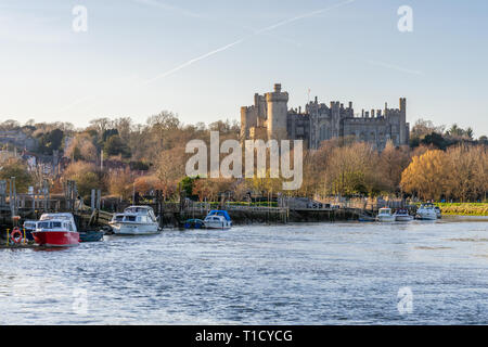 Arundel Castle, a restored medieval castle in the historic market town Arundel as seen from the banks of Arun river, West Sussex, England, UK - Stock Image