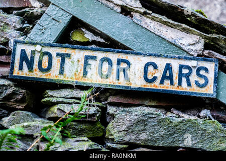 Not For Cars sign on track up Helm Crag near Grasmere, Lake District, Cumbria - Stock Image