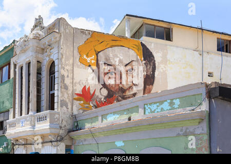 Painted wall with Cuban female face on a building in Havana, Cuba - Stock Image