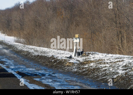 Mobile automatic camera radar on winter road - Stock Image