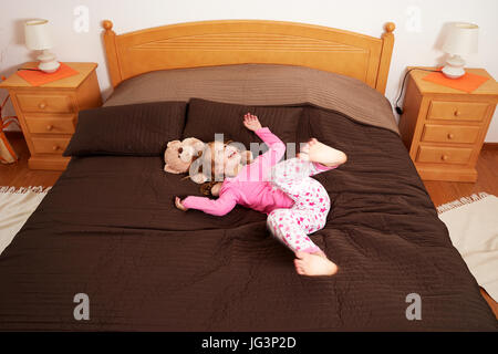 A happy little girl at home indoors - Stock Image