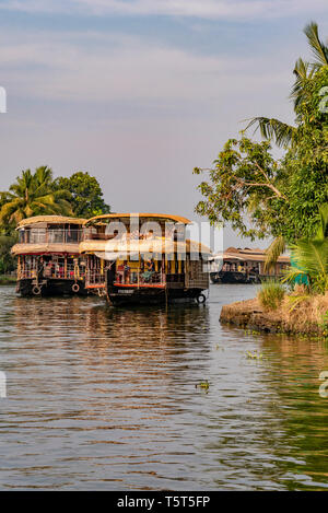 Vertical view of traditional riceboats sailing the backwaters of Kerala, India. - Stock Image