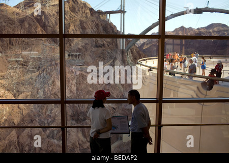 A couple take in the view of the Black Canyon and Colorado River below at the Hoover Dam Visitor Center in Boulder - Stock Image