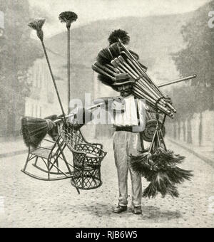 Broom vendor in a street of Rio de Janeiro, Brazil. - Stock Image