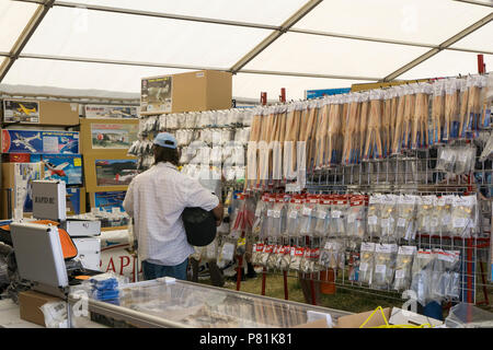 Customer perusing goods for sale at Wings and Wheels - Stock Image