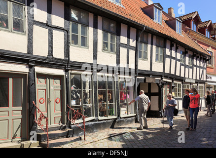 Shop in old timbered building with tourists in best kept medieval market town of Ebeltoft, Jutland, Denmark, Scandinavia - Stock Image