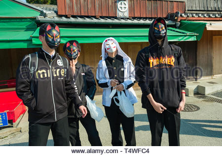 Teenaged boys wearing fox masks, Fushimi Inari Taisha Shinto shrine, Fukakusa Yabunouchicho, Fushimi Ward, Kyoto, Honshu, Japan - Stock Image